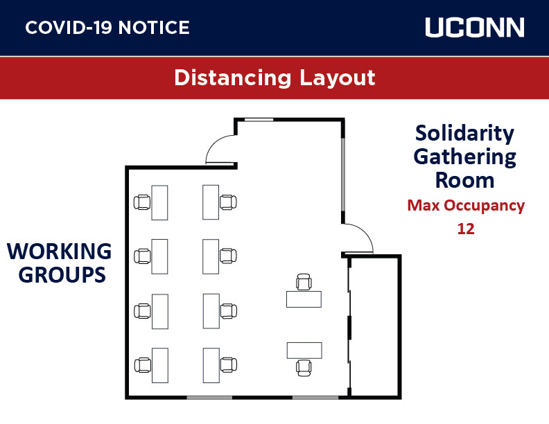 Solidarity room with working group tables and chairs
